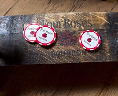 Four Roses bourbon barrel stave with poker chips
