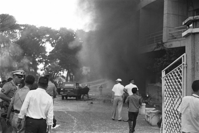 The Brink Hotel goes up in flames after Vietcong terrorist attempt, 24 December 1964 - by Francois Sully