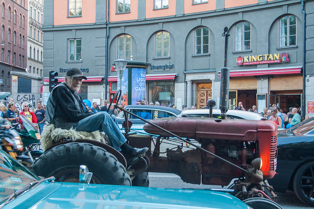 Man riding an old tractor in Stockholm