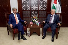 U.S. Secretary of State John Kerry sits with Palestinian Authority President Mahmoud Abbas before a bilateral meeting on November 24, 2015, at the Muqata'a Presidential Compound in Ramallah, West Bank. [State Department photo/ Public Domain]