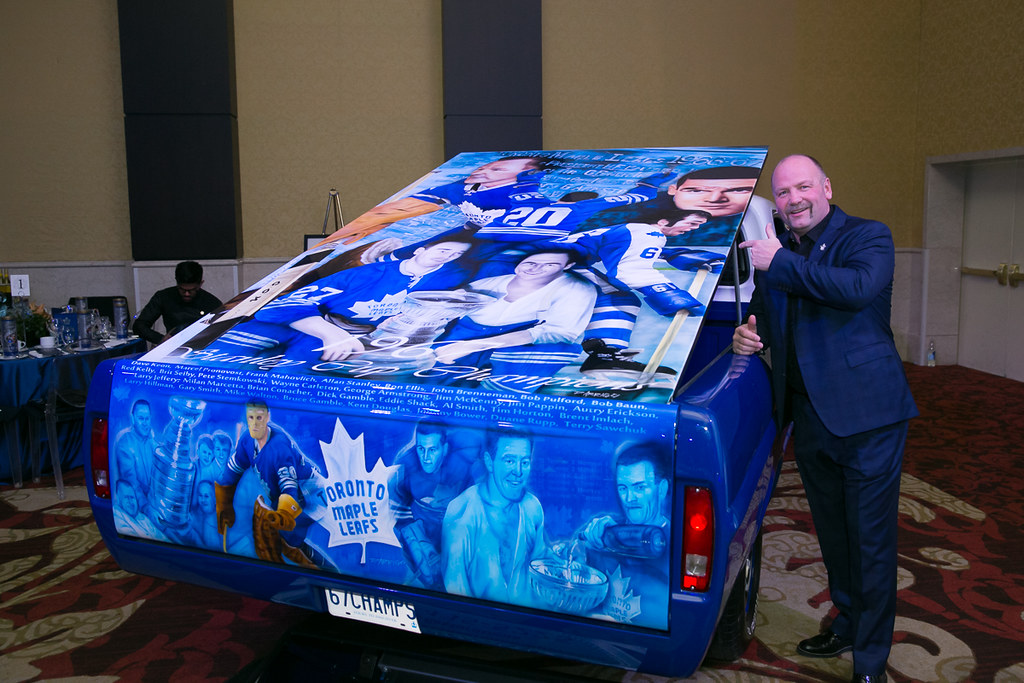 Maple Leafs alumnus Wendel Clark with a fan's custom truck auctioned at the Centennial Gala