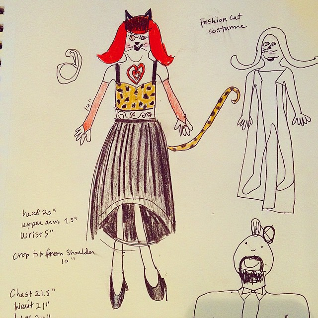 Meet Fashion Cat. Karlie and I designed her together and this will be her birthday present/Halloween costume. Complete with red wig, cat ears, a leopard print crop top, red arm coverings, a black tulle skirt, black heels and tattoos. She was very specific
