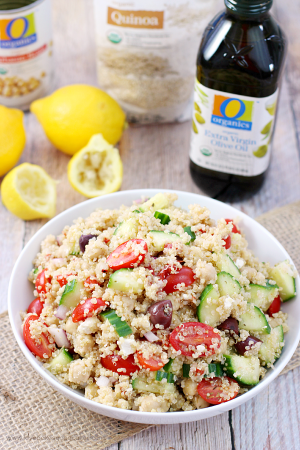 Mediterranean Quinoa Salad in a bowl with ingredients for recipe.