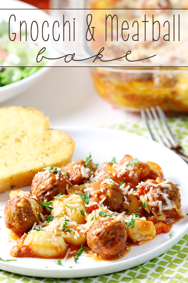 Gnocchi & Meatball Bake on a plate with garlic bread and a fork.