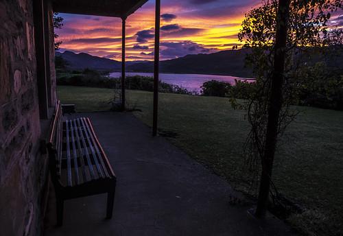 dawn sunrise sunup east sky clouds silhouettes shadows rhidorroch ullapool westerross rosshire highlands scotland house seat bench verandah garden morning