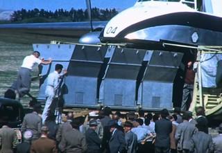 1954 NZ5904 Topdressing trials, Hood Aerodrome - Loading hoppers