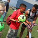 Charlie Davies signs an autograph at Revs Training
