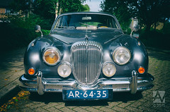 executive car(0.0), convertible(0.0), sports car(0.0), automobile(1.0), automotive exterior(1.0), daimler 250(1.0), jaguar xk140(1.0), jaguar mark 2(1.0), vehicle(1.0), automotive design(1.0), jaguar mark 1(1.0), mitsuoka viewt(1.0), jaguar xk150(1.0), antique car(1.0), classic car(1.0), vintage car(1.0), land vehicle(1.0), luxury vehicle(1.0), jaguar s-type(1.0),