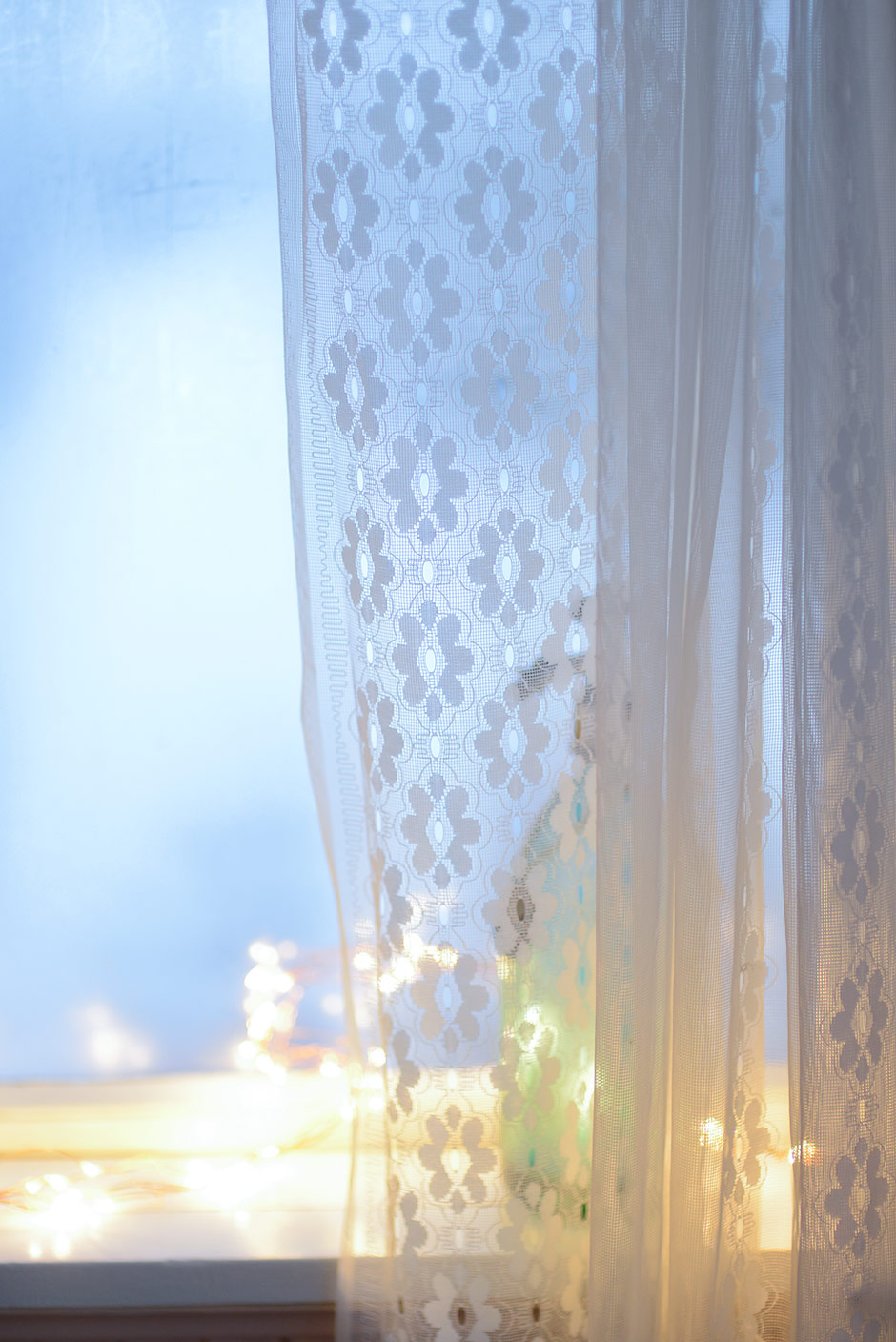 Wintery windowsill with fairy lights