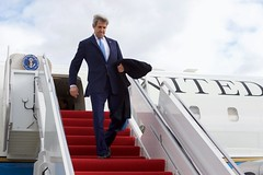 U.S. Secretary of State John Kerry disembarks from his U.S. Air Force plane on January 18, 2017, after it landed at Joint Base Andrews in Camp Springs, Maryland, on the last flight of his tenure as a Cabinet officer following his attendance at the World Economic Forum in Davos, Switzerland. [State Department photo/Public Domain]