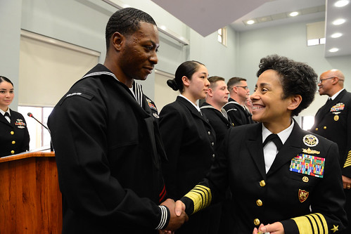 Fri, 01/27/2017 - 10:36 - 170127-N-SS492-570 NAVAL SUPPORT ACTIVITY NAPLES, Italy (Jan. 27, 2017) Commander, U.S. Naval Forces Europe-Africa, Adm. Michelle Howard, right, shakes hands with and presents a coin to Hospital Corpsman 1st Class Kenneth Terrell at the Commander, U.S. Naval Forces Europe-Africa Sailor of the Year ceremony Jan. 27, 2017.  U.S. Naval Forces Europe-Africa, headquartered in Naples, Italy, oversees joint and naval operations, often in concert with allied, joint, and interagency partners, to enable enduring relationships, and increase vigilance and resilience in Europe and Africa. (U.S. Navy photo by Chief Mass Communication Specialist Brian P. Biller/Released)