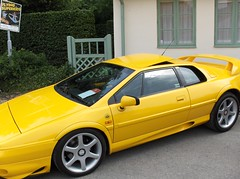 race car, automobile, lotus, automotive exterior, wheel, vehicle, lotus esprit, land vehicle, luxury vehicle, coupã©, supercar, sports car,