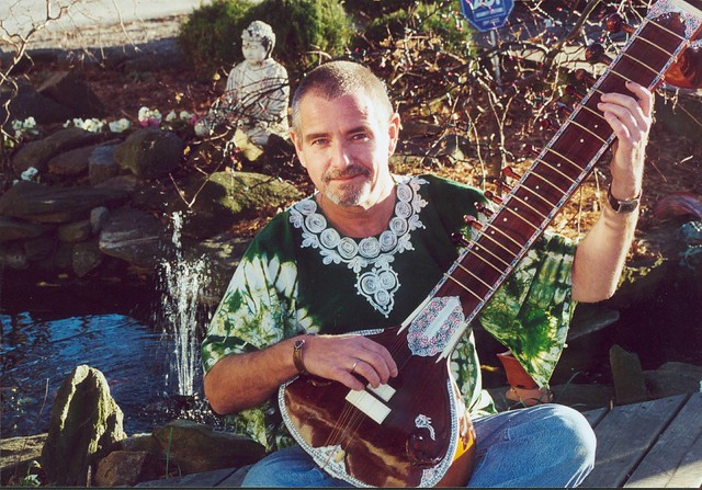 Billy and his Sitar by the Pond