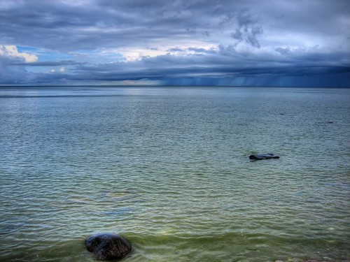 blue lake storm green water rock stone clouds dark michigan wave lakemichigan hdr