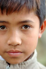 infant(0.0), child(1.0), nose(1.0), chin(1.0), face(1.0), hairstyle(1.0), portrait photography(1.0), skin(1.0), lip(1.0), male(1.0), head(1.0), hair(1.0), cheek(1.0), brown hair(1.0), close-up(1.0), eyebrow(1.0), forehead(1.0), person(1.0), portrait(1.0), boy(1.0), eye(1.0), organ(1.0),