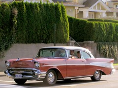 compact car(0.0), convertible(0.0), automobile(1.0), automotive exterior(1.0), 1957 chevrolet(1.0), vehicle(1.0), antique car(1.0), chevrolet bel air(1.0), sedan(1.0), land vehicle(1.0), luxury vehicle(1.0), coupã©(1.0),