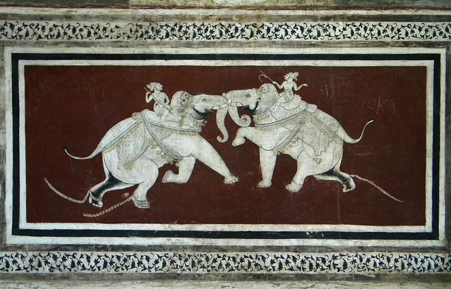 A mural of two elephants fighting on a wall in the Bundi Fort in India