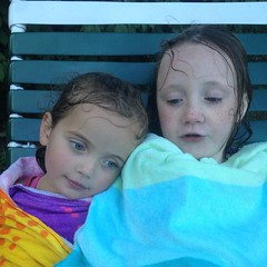 They were tired and a bit cold after swimming last night. #sisters #swim #pool #sweetness #latergram