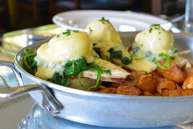 Eggs Benedict smoked turkey, spinach, english muffins, poached egg, roasted potatoes, sauce hollandaise