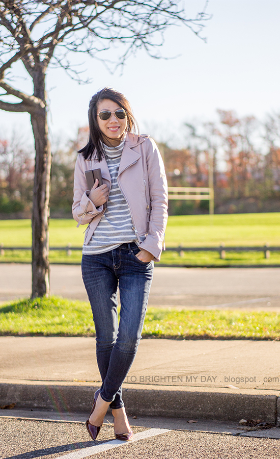 lilac leather jacket, gray striped turtleneck, jeans, taupe clutch, burgundy pumps