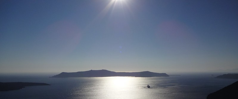 Photo: Volcano and boat from Santorini, in Greece
