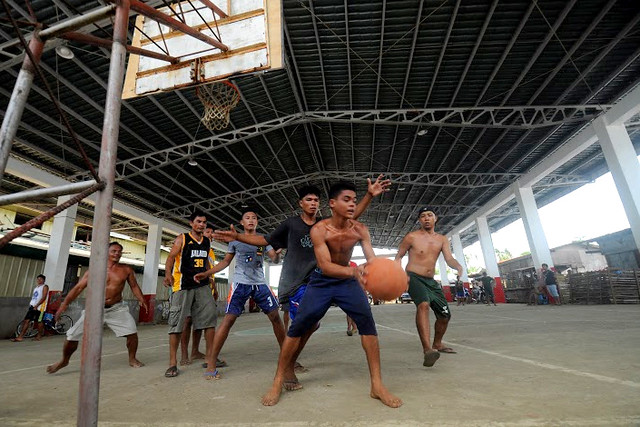 Basketball games in the newly-rehabilitated Estancia Civic Center