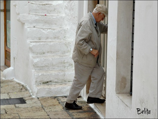 stepping over the threshold - Cisternino town (Puglia-Italy)