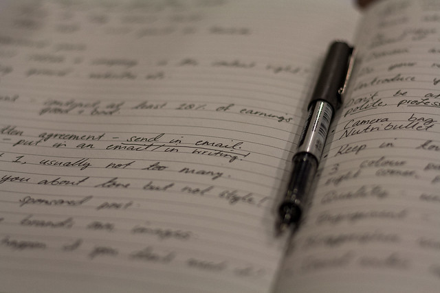 Taking notes in a seminar at the Big Blogger Conference