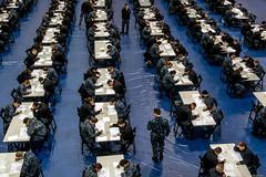 Sailors take the Navy-wide E-4 advancement exam at James D. Kelly Fleet Recreation Center.