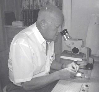 Bob Vlack at microscope