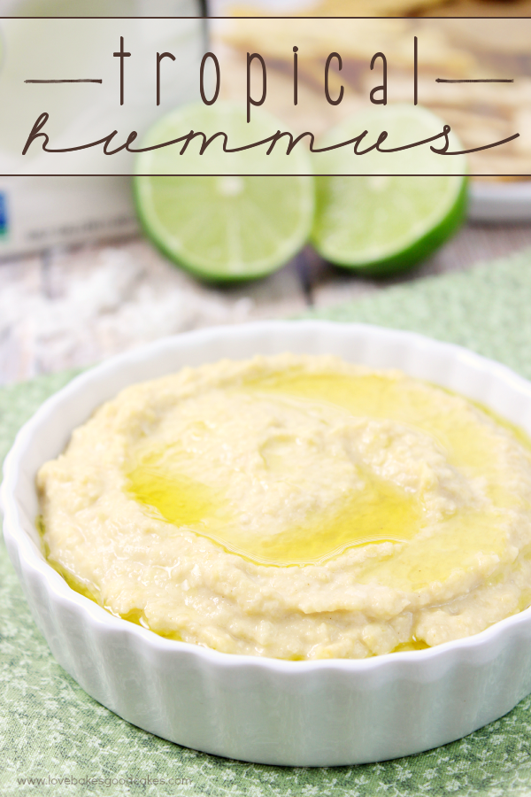 Tropical Hummus in a white bowl with limes.