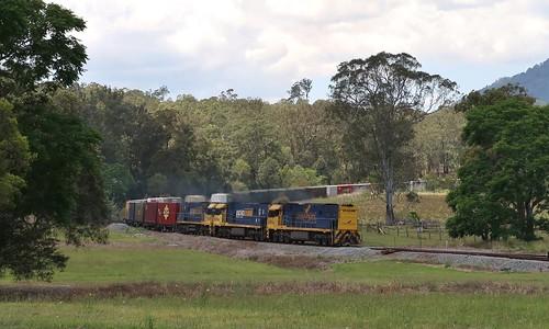 Running long end leading due to an earlier loco failure, NR27+NR69+NR44 bring train 6BA6 through Mount George, NSW. (4)