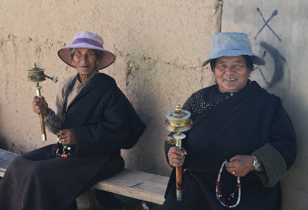 Older Tibetan woman's with a praying mile
