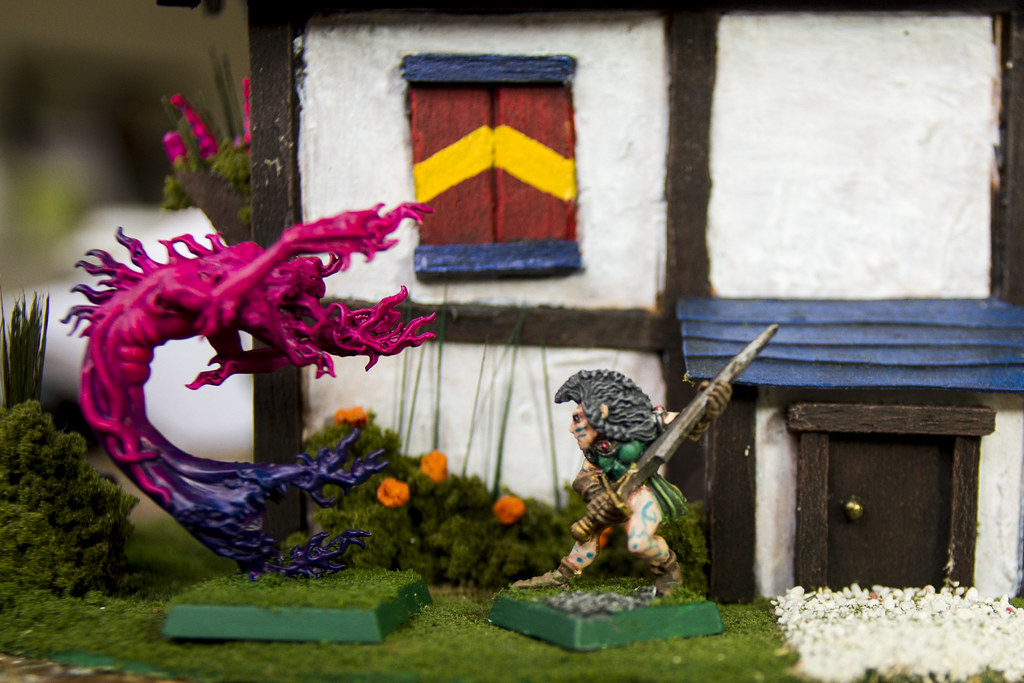 Model House: Wood elf battling a daemon outside