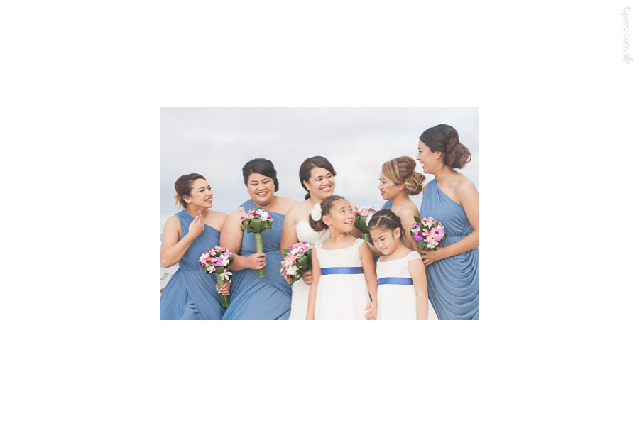 Candid. bridesmaids, flower girls, tropical wedding dresses