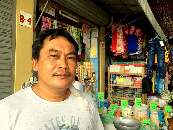 Tabuelan market vendor Arthuro B. Vincente