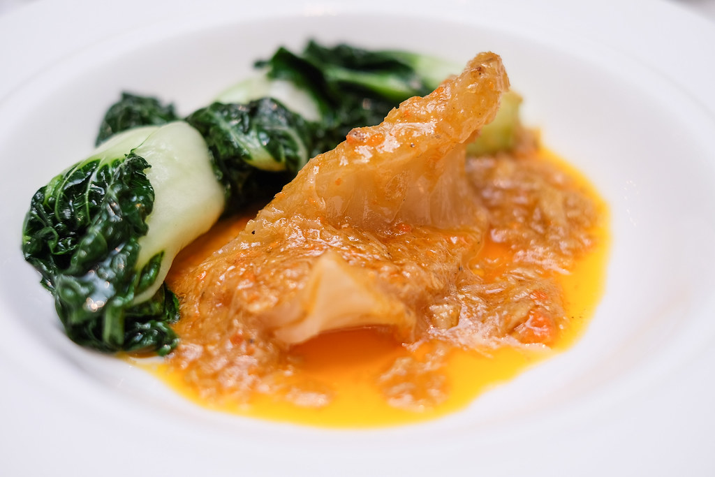Yan Ting Restaurant: Silvers of fish maw is drizzled with thick and flavourful hairy creab sauce full of roe and paired with bak choy.