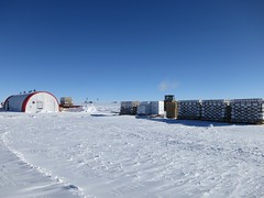 On the left is the drill tent and on the right are several pallets of empty ice core boxes
