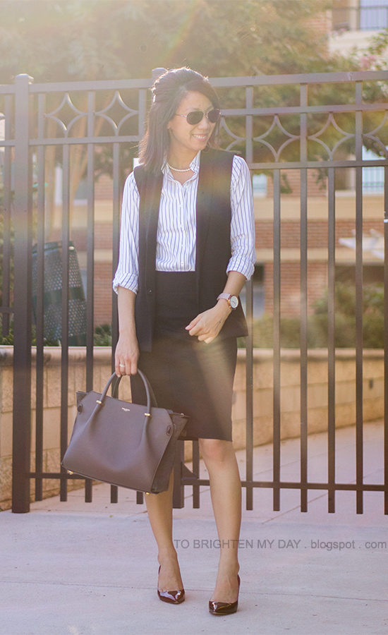 black vest, striped button up shirt, black pencil skirt, oversized watch, burgundy pumps