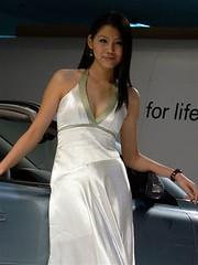 automobile, automotive exterior, model, abdomen, vehicle, showgirl, auto show, limb, woman, fashion, female, photo shoot, lady, person, beauty, dress,