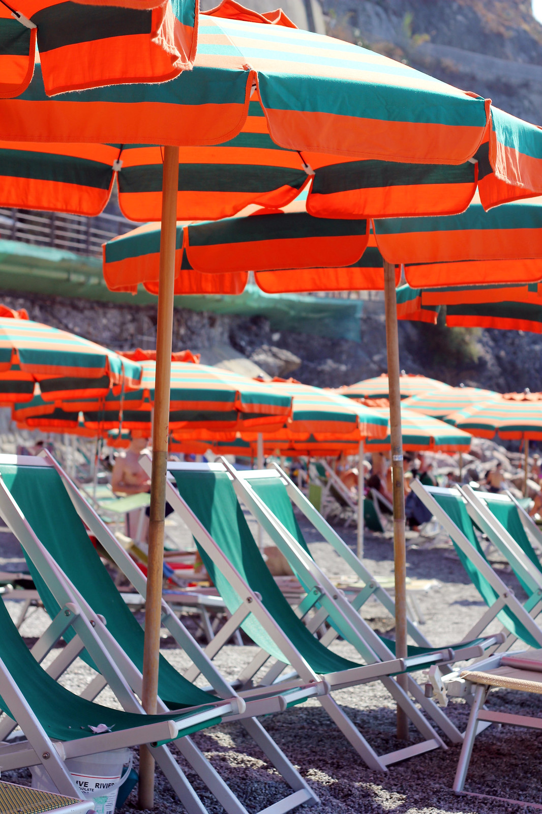 Monterosso Cinque Terre orange and green umbrellas and lounge chairs