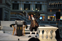 A magician performing in The Venetian