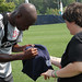 Jose Goncalves signs an autograph at Revs Training