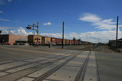 The Salinas Local heads for Spreckles Junction across the East Alisal Street grade crossing