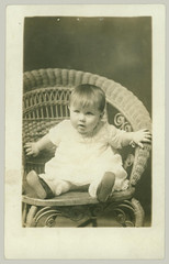 Baby in rattan chair