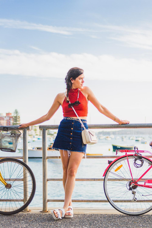 seventies style look with button up denim skirt, asos halterneck crop top and radley bag