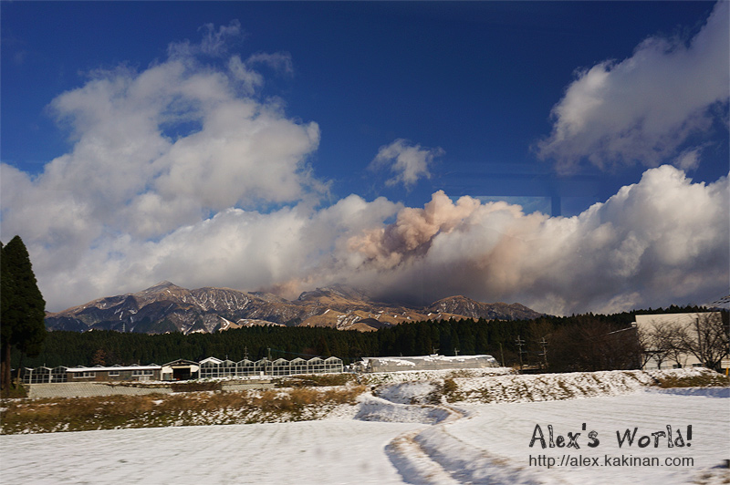 Mount Aso spilling ashes from far