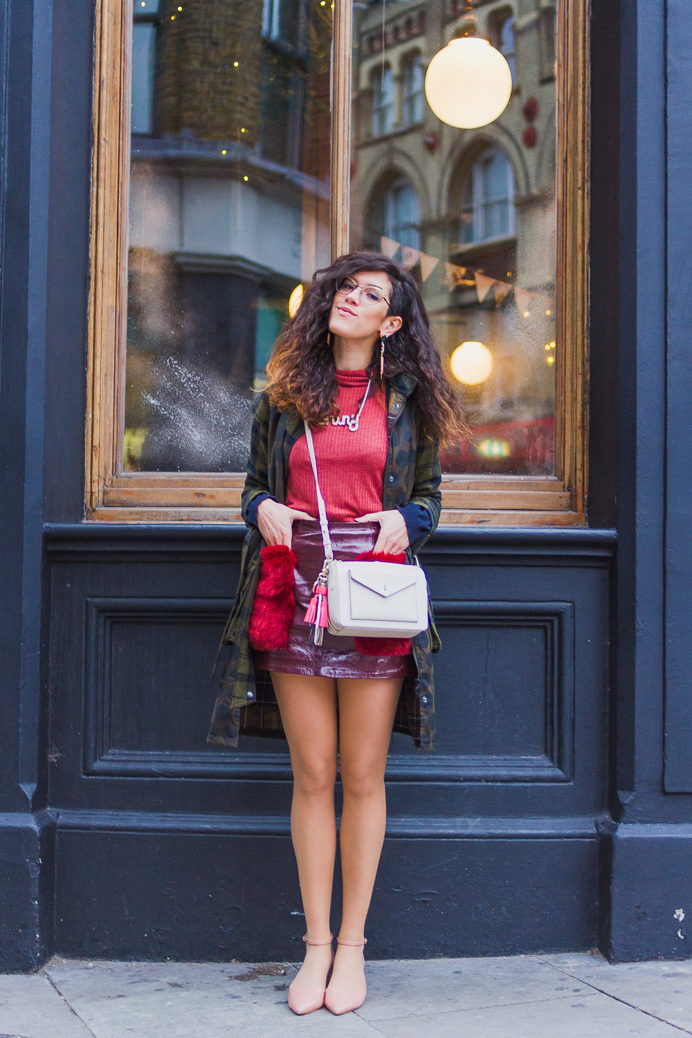 roll neck patent mini skirt outfit winter rich red colours barbour coat