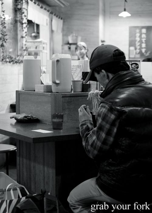 Ramen eaters at Yoshiyama Shouten at Sapporo Ramen Kyowakoku or Sapporo Ramen Alley, Hokkaido