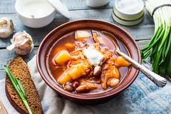 red borsch with beans, sour cream, wild garlic, ry…